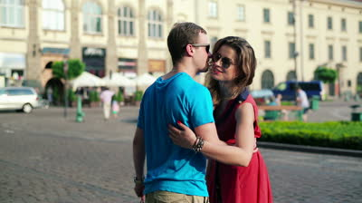 stock-footage-young-couple-meeting-after-shopping-in-the-city