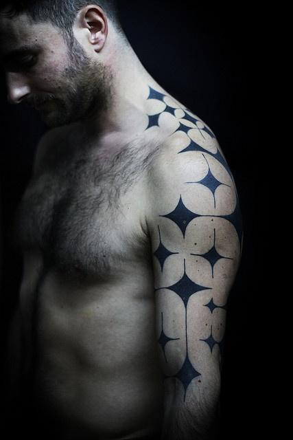 black-ink-geometric-tattoo-on-man-left-half-sleeve