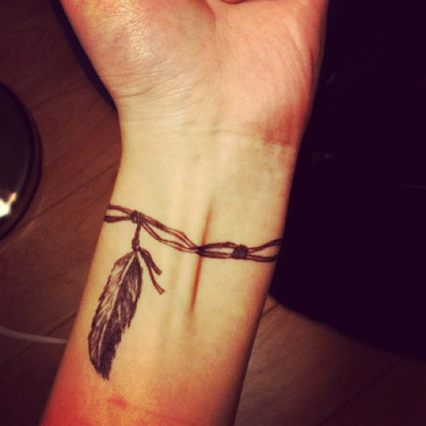 Very-Cool-Feather-Bracelet-Tattoo-Design-for-women