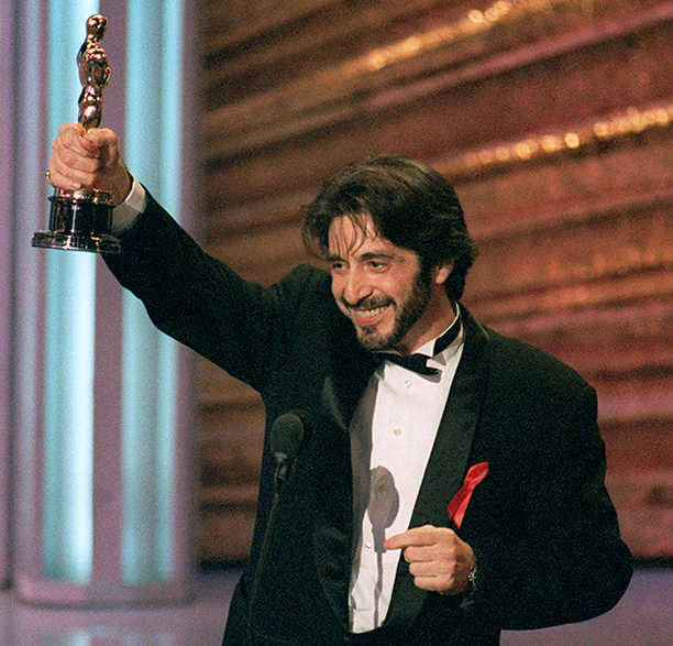 US actor Al Pacino holds up his Oscar during the 6