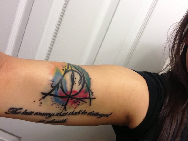 color-deathly-hallows-tattoo-on-sleeve