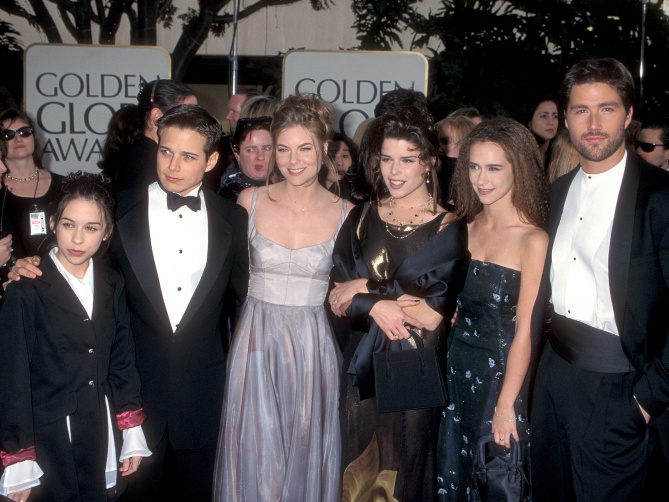 BEVERLY HILLS, CA - JANUARY 19:   Actress Lacey Chabert, actor Scott Wolf, actress Paula Devicq, actress Neve Campbell, actress Jennifer Love Hewitt and actor Matthew Fox attend the 54th Annual Golden Globe Awards on January 19, 1997 at the Beverly Hilton Hotel in Beverly Hills, California. (Photo by Ron Galella, Ltd./WireImage)