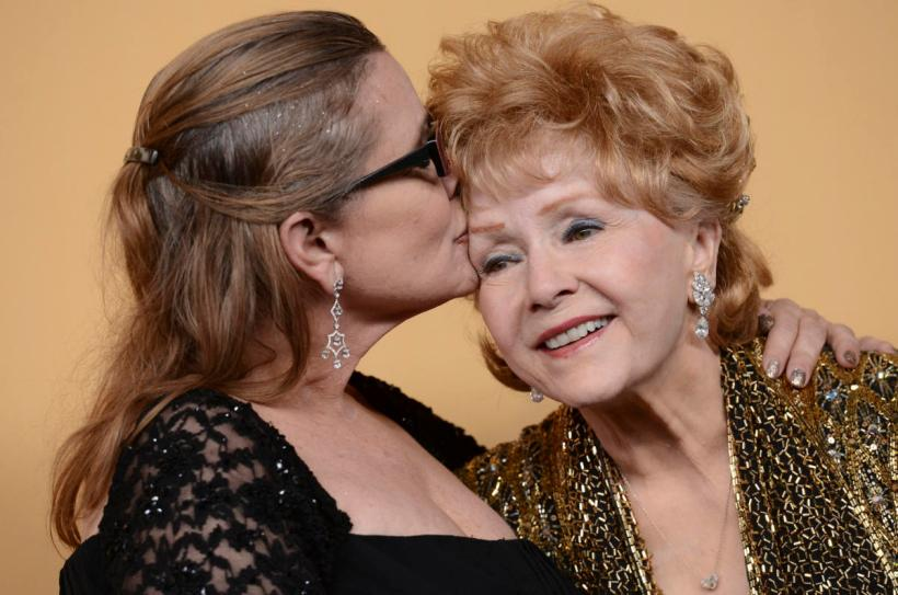 File photo - Debbie Reynolds and Carrie Fisher pose in the press room at the 21st Annual Screen Actors Guild Awards at The Shrine Auditorium in Los Angeles, CA, USA, on January 25, 2015. Debbie Reynolds, who starred opposite Gene Kelly in the 1952 musical Singin' in the Rain, has died a day after the death of her daughter, Carrie Fisher, on December 28, 2016. Photo by Lionel Hahn/Sipa USA(Sipa via AP Images)